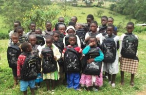 chem_children_after_receiving_books_bags_,pens_and_pencils_from_Egessa_Dorothy